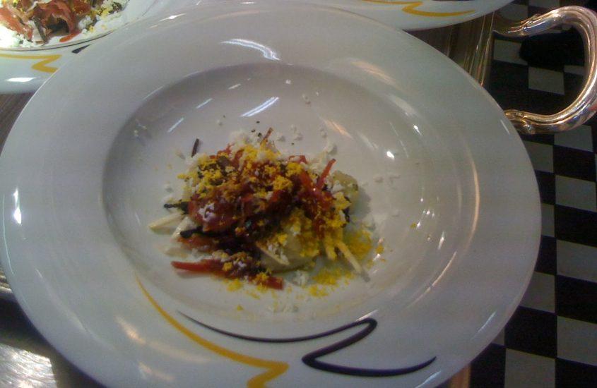 Insalata di culatello con topinambur, tartufo nero e funghi trombetta